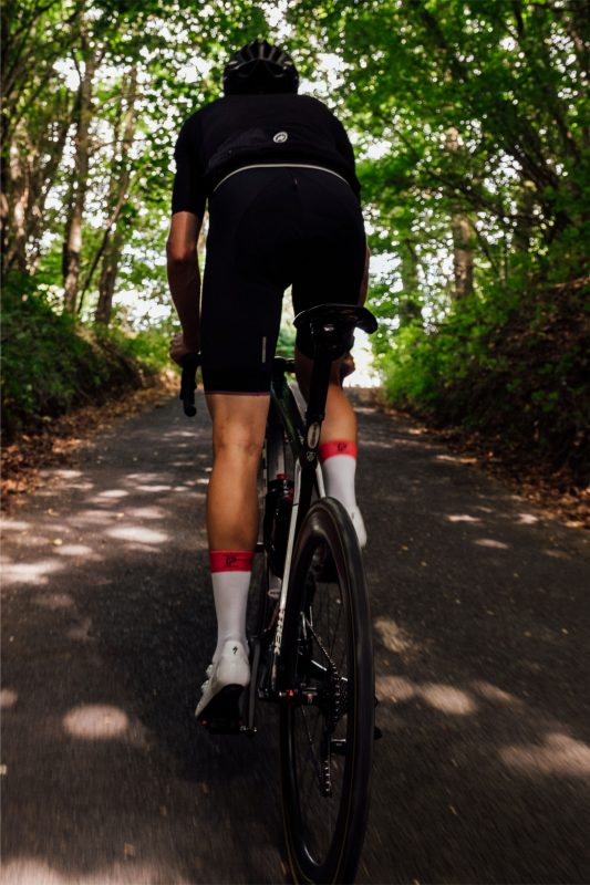 Cyclist pedaling uphill out of saddle